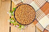 picture of buckwheat  - Buckwheat in a bowl with a flower buckwheat - JPG
