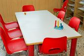 Table With Red Chairs Of A School Class For Children