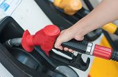 stock photo of fuel economy  - Pumping gas at gas pump - JPG