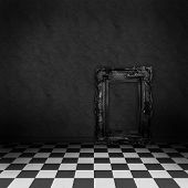 Empty, dark, psychedelic room with black and white checker on the floor and empty black frame