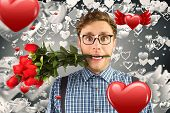 pic of love bite  - Geeky hipster biting a bunch of roses against grey valentines heart pattern - JPG