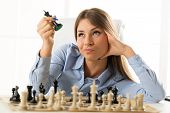 Young Pretty Businesswoman With Chessmen