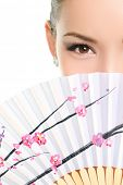 picture of seduction  - Asian chinese woman looking seductive with paper fan - JPG