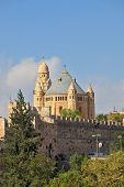 The Church  in Jerusalem. Battlements of Jerusalem surrounded by majestic building. The morning sun illuminates the dome