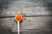 Scoop Of Red Caviar On The Wooden Background