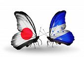 Two Butterflies With Flags On Wings As Symbol Of Relations Japan And Honduras