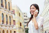 image of senators  - Business woman talking on smart phone in Macau - JPG