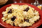 image of kalamata olives  - A bowl of chicken with orzo and Kalamata olives