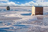 picture of shacks  - Rustic ice fishing shacks out on the ice - JPG