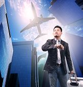 picture of air transport  - business man and belonging luggage standing against urban building and air plane flying above use for air transportation and people traveling by air liner - JPG