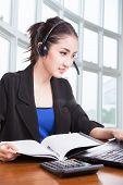 Friendly Asian Female Helpline Operator With Headphones
