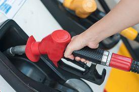 stock photo of fuel pump  - Pumping gas at gas pump - JPG