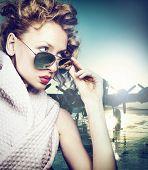 stock photo of aeroplane  - Beautiful blonde woman posing in sunglasses - JPG