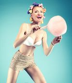 foto of candy cotton  - Happy beautiful young woman eating candy cotton - JPG