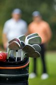 image of golf bag  - Golf clubs in bag at golf course - JPG