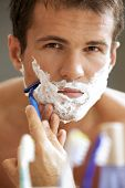 picture of shaved head  - Portrait of young man shaving - JPG