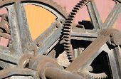 stock photo of reduce  - Old mechanism with large gear reducer - JPG