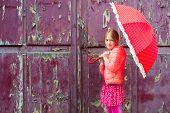 picture of girl next door  - Portrait of a cute little girl next to old purple wooden door - JPG