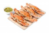 picture of cooked blue crab  - Steamed flower crab served on wooden chopping board with spicy chili dip sauce - JPG