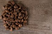 image of brew  - roasted coffee beans on wooden table ready to brew delicious coffee - JPG