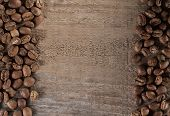 picture of brew  - roasted coffee beans on wooden table ready to brew delicious coffee - JPG