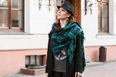 stock photo of cloak  - Pretty woman in black cloak looking up - JPG