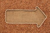 picture of buckwheat  - Pointer made from rope with grain buckwheat lying on sackcloth with space for your text - JPG