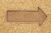 stock photo of sackcloth  - Pointer made from rope with grain barley lying on sackcloth with space for your text - JPG