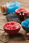 stock photo of scrubs  - Sea salt and scrub for body on wooden background - JPG