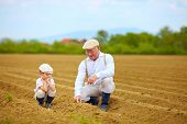 pic of grandpa  - grandpa explaining his grandson the way plants are grow - JPG