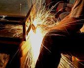 Man Grinding Steel
