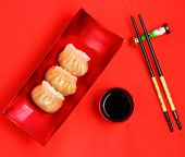 pic of siomai  - Vietnam style steamed shrimp dumplings served on a red background - JPG