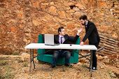stock photo of argument  - Argument ensuing in a grunge office a business concept - JPG