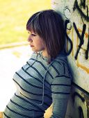 picture of graffiti  - Teenage girl leaning on a graffiti wall - JPG