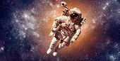 Astronaut in outer space against the backdrop of the planet earth. Elements of this image furnished  poster