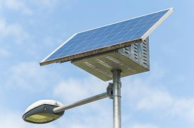 stock photo of solar battery  - Street Light powered by a solar panel with a battery included - JPG