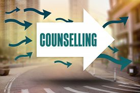 stock photo of counseling  - The word counselling and arrows against new york street - JPG