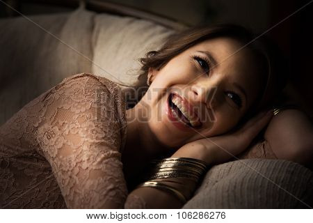 rich young woman smiling wearing