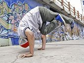 Portrait Of A Breakdancer Handstanding