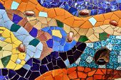 stock photo of gaudi barcelona  - Detail of mosaic in Guell park in Barcelona Spain - JPG
