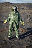 picture of scoria  - A man in a chemical protective suit stands in the desert - JPG
