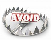 Avoid red 3d word on a steel bear trap warning you to stay away from dangerous hazard or obstacle poster