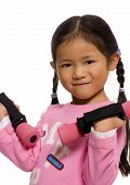 stock photo of weight-lifting  - a young child lifts some colorful weights - JPG