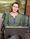 Mature Woman Portrait At Her Laptop Computer
