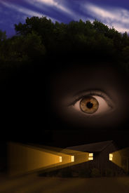 stock photo of scary haunted  - Scary haunted house in forest with light beams coming from windows and floating eye - JPG