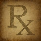 pic of prescription pad  - Rx Prescription for a pharmacist symbol in a grunge vintage look on parchement paper representing the medicine recomended by medical doctor - JPG