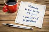 Nobody is too busy, it is a matter of priorities - handwriting on a napkin with a cup of espresso co poster