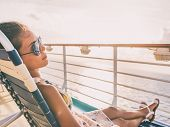 Cruise ship vacation travel woman relaxing sun tanning lying down on lounger chair on deck balcony.  poster