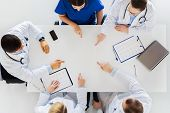 medicine, healthcare and cardiology concept - group of doctors with cardiograms, clipboards and lapt poster