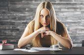 Pensive Woman Doing Paperwork poster
